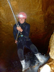 Stina rapelling down a waterfall in the cave!