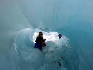 Stina going through an ice cave