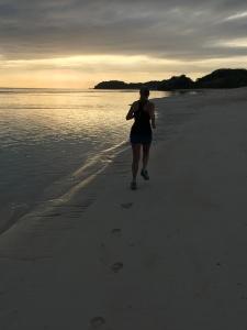 Morning run on sunset beach
