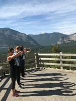 The girls and their homemade eclipse viewing tools on Tunnel Mountain
