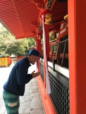 Neil praying at Fushimi Inari Shrine