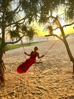 She can't resist a beach swing