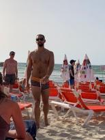 Drew slaying on the beach