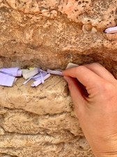 Placing my prayer note in the Wailing Wall